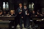 Tom Felton, Rupert Grint, Daniel Radcliffe, et Jamie Waylett dans Harry Potter à l'école des sorciers (2001)