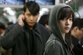 Jung Woo-sung et Han Hyo-joo dans Cold Eyes (2013)