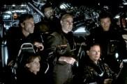 Hilary Swank, Aaron Eckhart, Delroy Lindo, Stanley Tucci, Bruce Greenwood, et Tchely Karyo dans Fusion (2003).