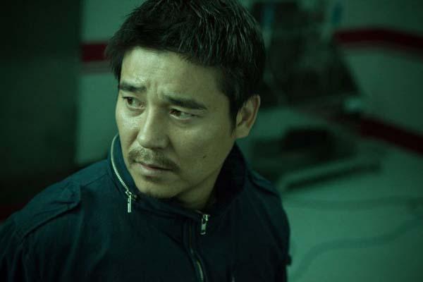 Im Chang-jung dans Traffickers (2012)