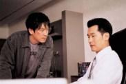 Sol Kyung-gu et Lee Sung-jae dans Public Enemy (2002)